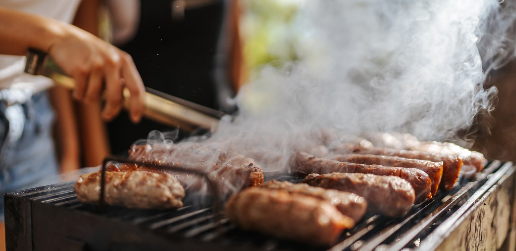 Sausages cooking on a BBQ